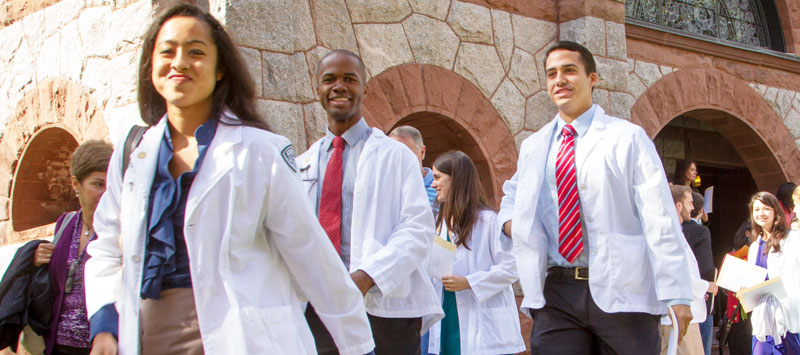 Geisel Students walking in White Coats